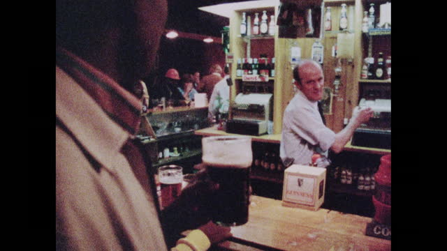 people ordering drinks at the bar in a london pub; 1973 - multiple image stock videos & royalty-free footage