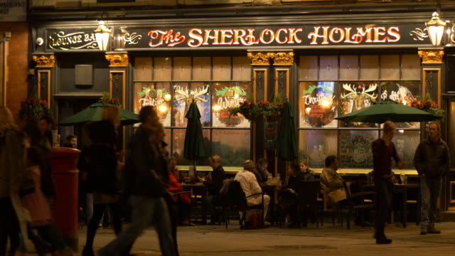 stockvideo's en b-roll-footage met people outside the sherlock holmes pub,westminster. - bar gebouw