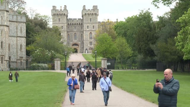 people outside windsor castle residency of the british royal family react to the birth of harry's and meghan's son - royalty stock videos & royalty-free footage