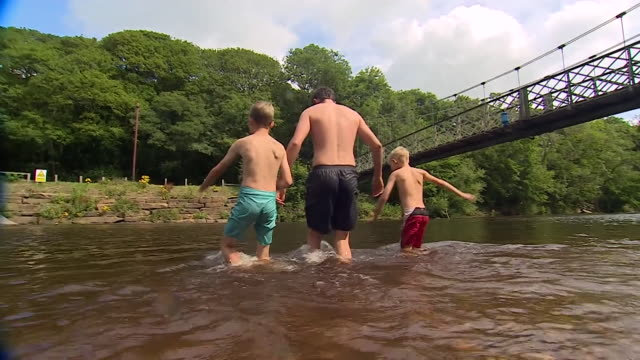 people paddling and swimming in rivers ilkley - swimming stock videos & royalty-free footage