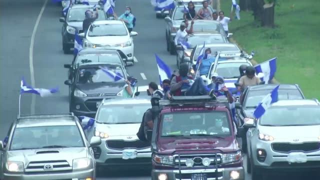 people parade in cars and motorcycles from managua to ticuantepe in nicaragua demanding the resignation of president daniel ortega - managua stock videos & royalty-free footage