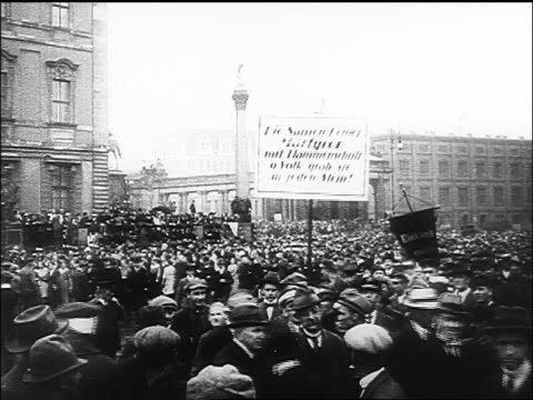 B/W 1918 people parading in large plaza of Germany carrying signs / documentary