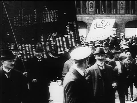 B/W 1918 people parading thru streets of Germany carrying banners / documentary