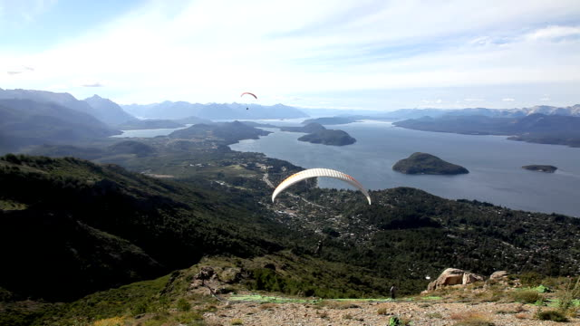 people paragliding in bariloche, argentina - argentina stock videos & royalty-free footage