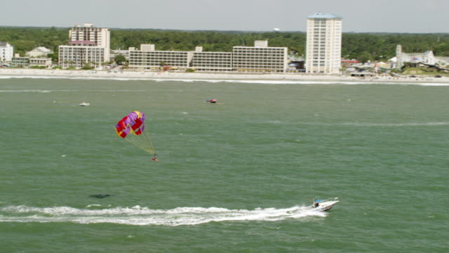 ws zo aerial pov people parascending on sea / myrtle beach, south carolina, united states - carolina beach stock videos & royalty-free footage