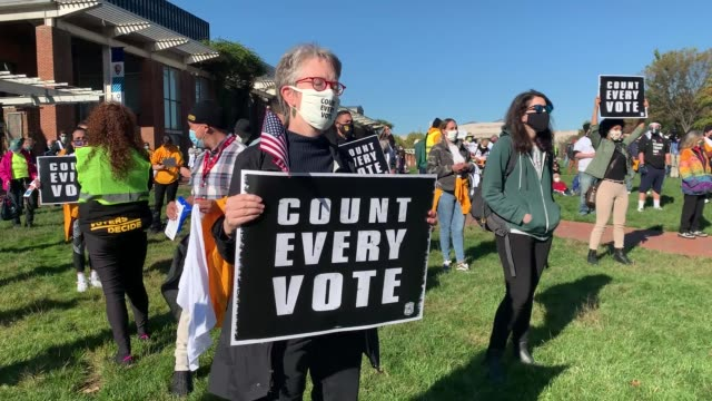 people participate in a protest in support of counting all votes as the election in pennsylvania is still unresolved on november 04, 2020 in... - philadelphia pennsylvania stock-videos und b-roll-filmmaterial