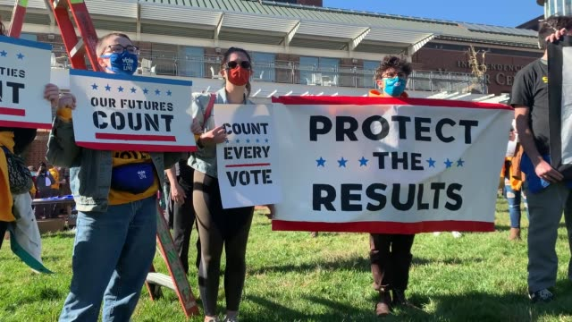 stockvideo's en b-roll-footage met people participate in a protest in support of counting all votes as the election in pennsylvania is still unresolved on november 04, 2020 in... - verkiezing