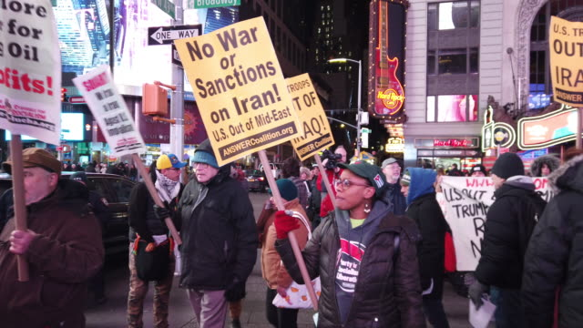 people participate in a protest in times square against military conflict with iran on january 08 2020 in new york city united states the no war with... - iran stock videos & royalty-free footage