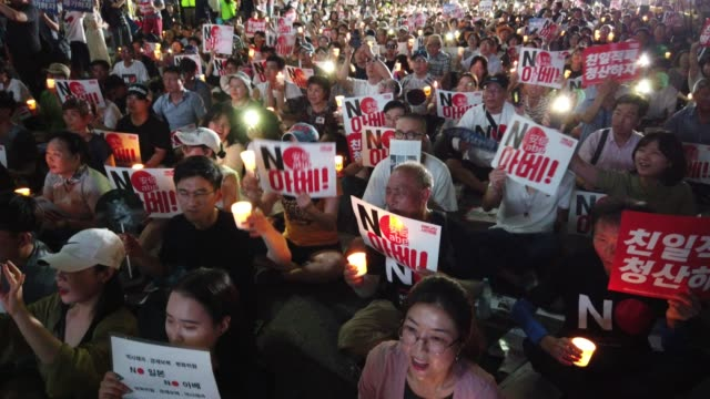 people participate in a rally to denounce japan's new trade restrictions on south korea in front of the japanese embassy on august 10 2019 in seoul... - korea stock videos & royalty-free footage