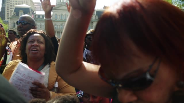 people participate in the rally at city hall. baltimore, maryland. may 3, 2015. freddie gray was arrested for possessing a switch blade knife april... - maryland us state stock videos & royalty-free footage