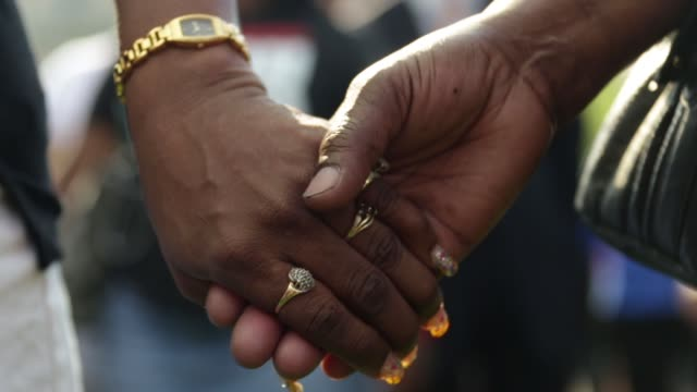 people participate in the rally at city hall. baltimore, maryland. may 3, 2015. freddie gray was arrested for possessing a switch blade knife april... - holding hands stock videos & royalty-free footage