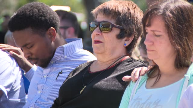 people participated in a prayer vigil for parkland shooting victims - memorial event stock videos & royalty-free footage