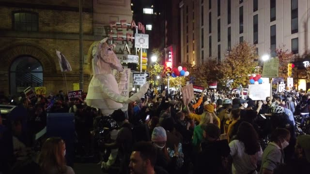people participating in a protest in support of counting all votes, hold signs and chant slogans at supporters of u.s. president donald trump outside... - philadelphia pennsylvania stock-videos und b-roll-filmmaterial