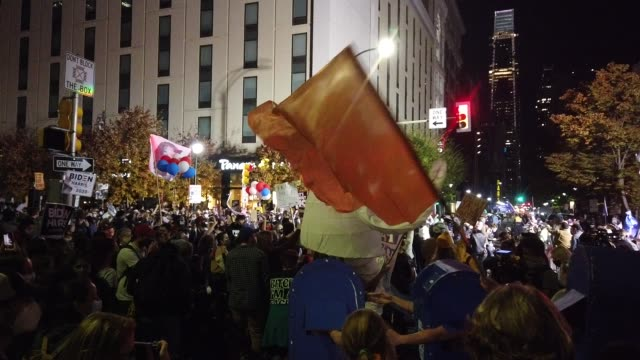 stockvideo's en b-roll-footage met people participating in a protest in support of counting all votes, hold signs and chant slogans at supporters of u.s. president donald trump outside... - philadelphia pennsylvania