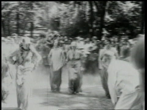 stockvideo's en b-roll-footage met 1924 montage people participating in sack and running races / detroit, michigan, united states - men