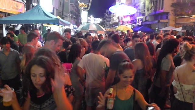 people party on khao san road in the backpackers area of bang lump phu in bangkok - street party stock videos & royalty-free footage