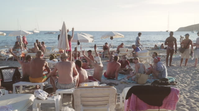 ms people party on playa de las salinas beach / ibiza, spain - balearic islands stock videos and b-roll footage