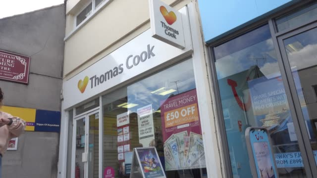 People pass a branch of Thomas Cook holiday shop on September 24 2018 in Keynsham England The travel agent Thomas Cook has blamed the summer heatwave...