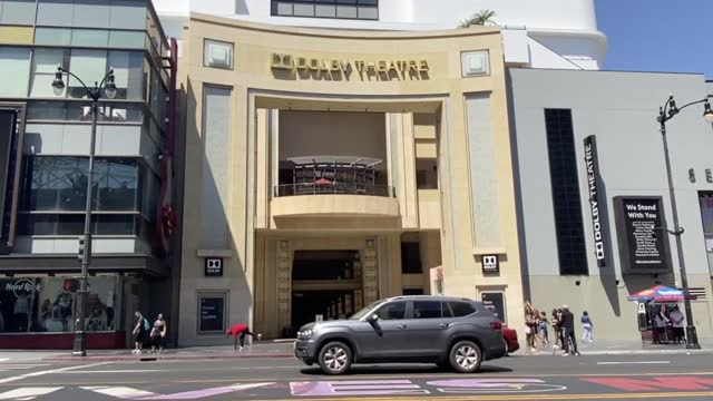"""people pass by the dolby theatre during preparations for the 93rd annual academy awards on april 19, 2021 in los angeles, california. """" - the dolby theatre stock videos & royalty-free footage"""
