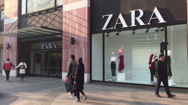 People pass by the Zara store at Solana shopping mall on Feb 12 2017 in Beijing China
