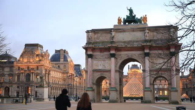 """people pass next to the """"arc de triomphe du carrousel"""", as background the louvre pyramid at dusk on january 7, 2021 in paris, france. unlike the... - atmospheric mood stock videos & royalty-free footage"""