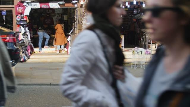 people pass souvenir shop, camden high st - street style点の映像素材/bロール