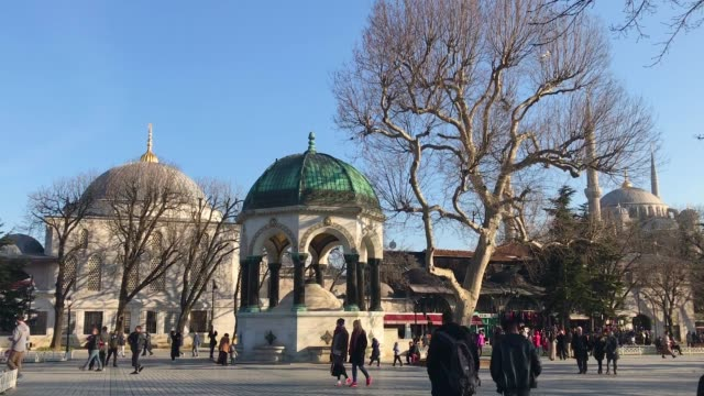people pass the german fountain in istanbul's sultanahmet district on march 9 2018 in istanbul turkey - sultanahmet district stock videos and b-roll footage