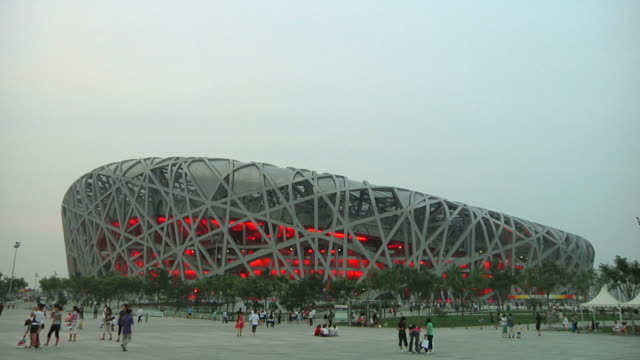 t/l ws people passing bird's nest olympic stadium / beijing, china - bird's nest stock videos & royalty-free footage