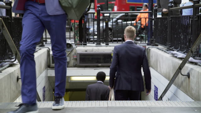 people passing by at london underground station - moving past video stock e b–roll
