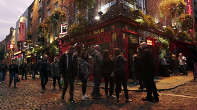 People Passing By The Temple Bar Pub In Dublin