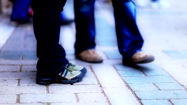 HD: People Passing Through the Crosswalk - Slow Motion