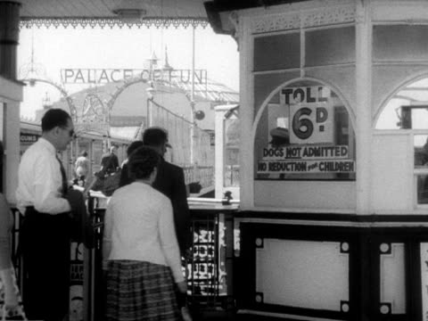 people pay an admission fee to access brighton's palace pier - fee stock videos and b-roll footage