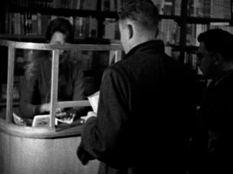 people pay for their copies of lady chatterley's lover at a cashier's desk in a london bookshop 1960 - paying stock videos & royalty-free footage