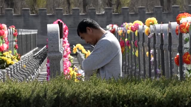 people pay their respects at a cemetery ahead of the annual qingming festival or tomb sweeping day when chinese traditionally tend the graves of... - afterlife stock videos and b-roll footage