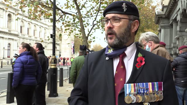 people pay tribute with a two minute silence at the cenotaph in london for armistice day. interviews with simon edwards, 50 and vivien foster... - armistice stock videos & royalty-free footage