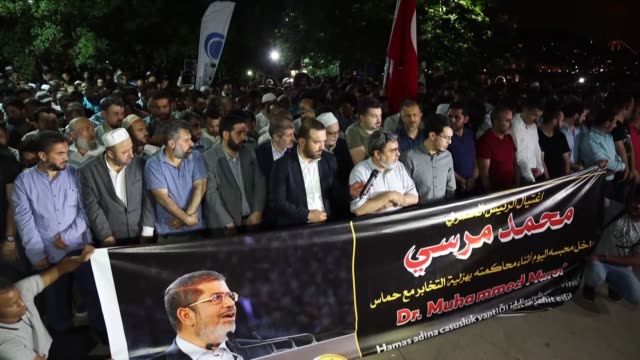 people perform a funeral prayer in absentia for former egyptian president mohamed morsi outside the consulate general of egypt in istanbul turkey on... - former stock videos and b-roll footage