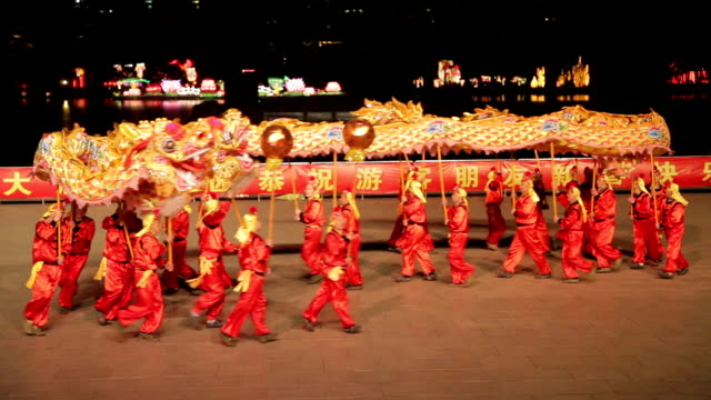 LS People perform dragon dance to celebrate Spring Festival of China.