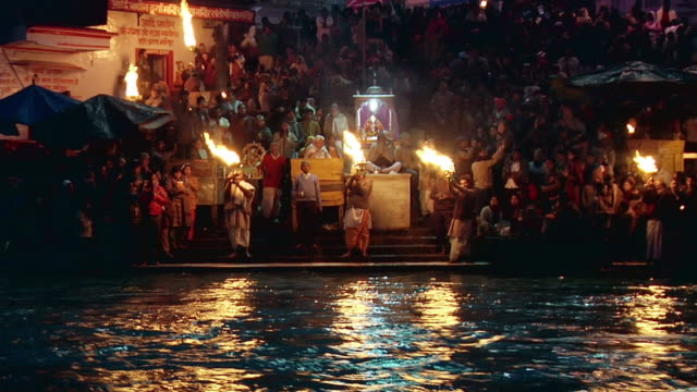 WS ZO People performing aarti at bank of river Ganges / Haridwar, Uttarakhand, India