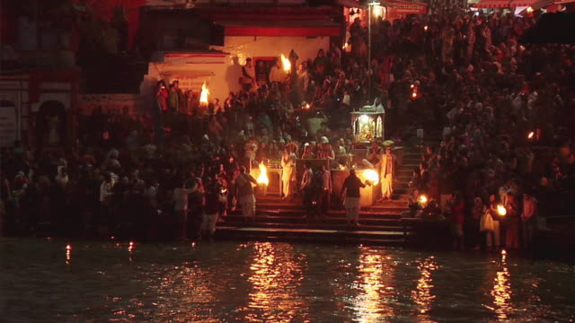 WS ZO People performing aarti at bank of river Ganges / Har-ki-pauri, Haridwar, Uttarakhand, India