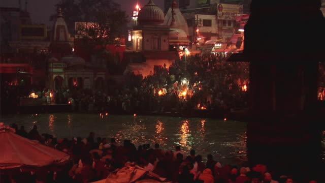 WS ZO People performing aarti at bank of river Ganges / Har-ki-pauri, Haridwar, Uttarakhand, India