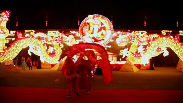 ms tu people performing dragon dance at city wall new year lantern festival  audio  / xi'an, shaanxi, china - dragon stock videos & royalty-free footage
