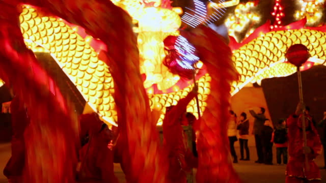 MS TS People performing dragon dance at city wall new year lantern festival  AUDIO  / xi'an, shaanxi, china