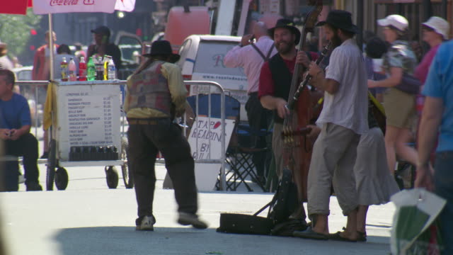 ms people performing music on street  / new orleans, louisiana, united states - new orleans video stock e b–roll