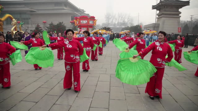 ms pan people performing yangko dance during chinese spring festival in park audio / xi'an, shaanxi, china - line stock videos & royalty-free footage