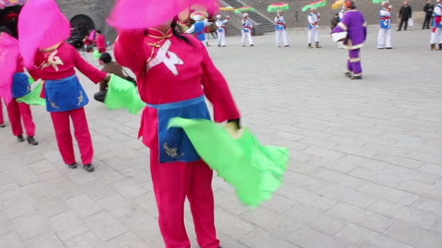swish pan ws people performing yangko dance during the spring festival/xian,shaanxi,china - in a row stock videos & royalty-free footage