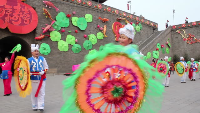 swish pan ws people performing yangko dance during the spring festival/xian,shaanxi,china - line stock videos & royalty-free footage