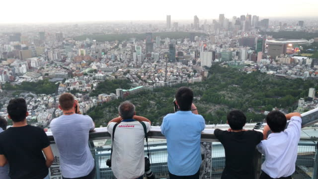 people photograph the city skyline from the roppongi hills mori tower on august 14 2019 in tokyo japan - roppongi hills stock videos and b-roll footage
