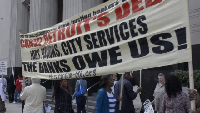 People picket outside Detroit bankruptcy court on August 02 2013 in Detroit Michigan