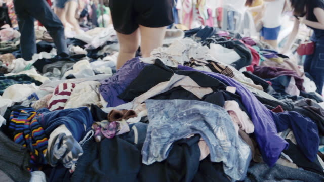 people picking and choosing clothes in the market, thailand. - fame stock videos & royalty-free footage