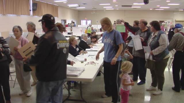ms, people picking up voting ballots from tables at polling place, st, marys, ohio, usa - voting ballot stock videos and b-roll footage